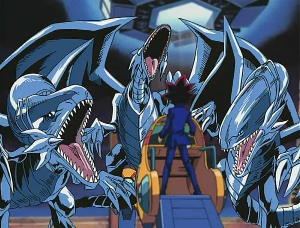 three blue eyes white dragons vs yami yugi first episode of yugioh